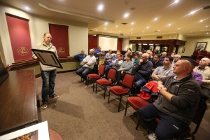 John Hall showing his work to members of the club